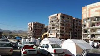 People Look Through Remains of Apartment Blocks to Salvage Items After Earthquake - Video