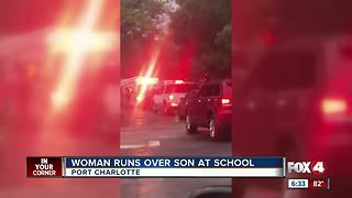 Woman runs over son at school - Video