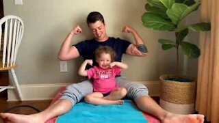 Little girl pulls her own weight during dad's exercise routine