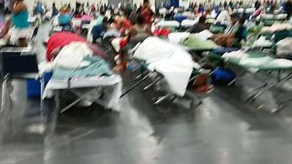 People Displaced by Harvey Camp at Houston Convention Center - Video
