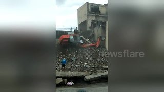 Lucky escape as digger rolls over with workman inside - Video