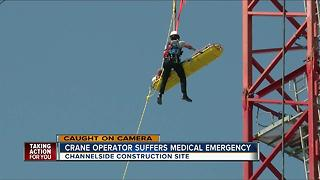 Crews rescue man who suffered medical emergency on crane in Tampa - Video