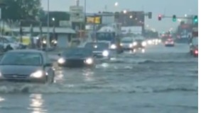 Cars Drive Through Flooded Road as Storm Hits Oklahoma