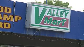 Robber chased off by Akron store employee armed with broom