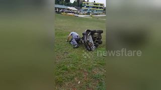 Hilarious moment worker falls off lawnmower