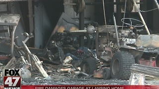 Fire damages garage at home in Lansing - Video