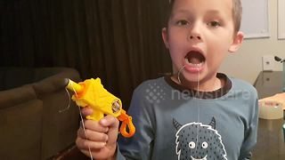 Look on boy's face after removing tooth with Nerf gun is priceless - Video