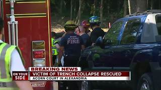 Officials rescue man trapped in collapsed trench - Video