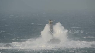 As snow blankets much of UK, huge waves batter Cornwall