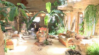 Tropical themed New Berlin home with private lake and indoor pool for sale