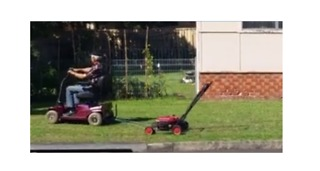 Man Uses Mobility Scooter to Help Mow His Lawn - Video