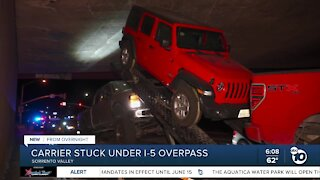 Vehicle carrier becomes stuck under I-5 overpass