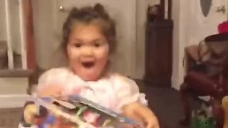 Little girl totally freaks out over Christmas present