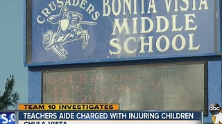 Teachers aide charged with injuring children - Video
