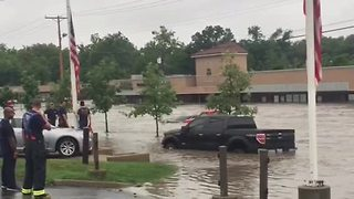 Business owners prepare for weekend storms after flash flooding - Video