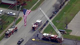 Procession for fallen Greenfield firefighter travels under Garrison - Video