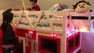 Little Boy Is Delighted by His New Fire Truck Bed - Video