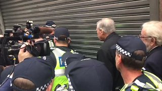 Cardinal George Pell Navigates Media Scrum During Court Appearance - Video