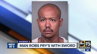 Man robs grocery store with sword - Video