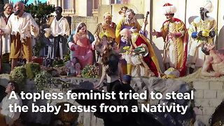 Topless Feminist Tries to Steal Baby Jesus From Manger - Video