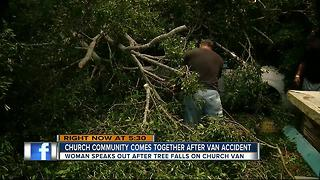 Church cleans up after storm knocks tree onto van - Video
