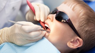 Boy gets his second needle at the dentist. - Video