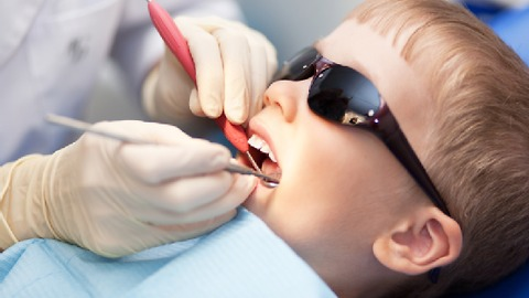 Boy gets his second needle at the dentist.