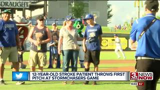 12-year-old stroke victim throws first pitch at Storm Chasers game - Video