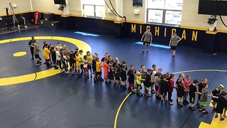 Michigan Wrestler Adam Coon Battles 50 Kids in Tug of War - Video