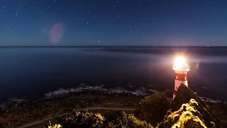 Swirling Galaxy Over Lighthouse Captured in Gorgeous Timelapse