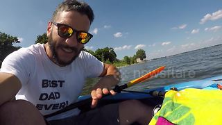 Hilarious moment man rescues bumblebee from drowning in lake
