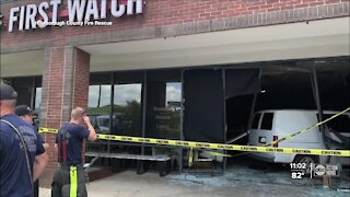 Van crashes into restaurant during busy lunch hour