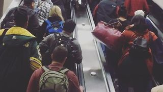 Travelers Walk Up Stopped Escalator During Atlanta Airport Power Outage - Video