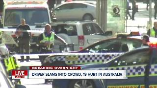 Driver arrested after slamming into crowd in Australia - Video