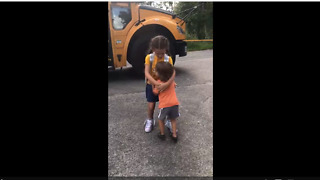Cute kid hugs sister when she gets off school bus