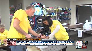 Volunteers wrap gifts for Crittenton kids - Video