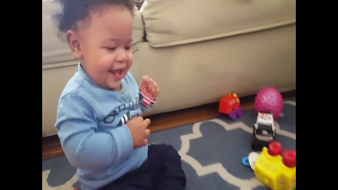 Baby gets a Case of the Giggles when Playing with Toy