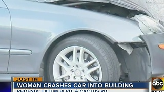 Woman crashes car into Valley business