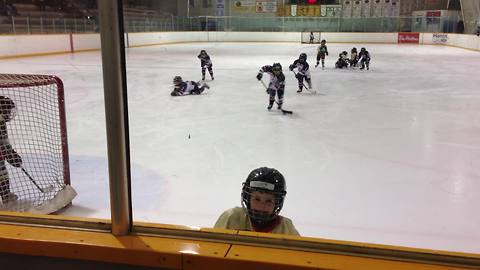 Toddler completely ignores hockey game - needs to use washroom!
