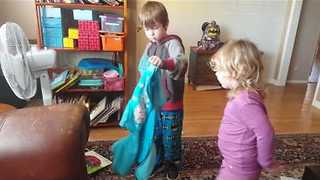 Adorable Brother Helps Little Sister With Jacket - Video