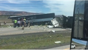 Wreckage on Highway After Deadly Collision Between Passenger Bus and Semi Truck - Video