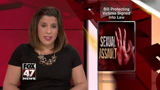 Bill protecting victims signed into law - Video
