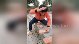 Kung fu master smashes his way through 50 bricks in 40 seconds