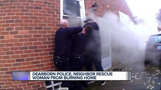 Video shows Dearborn officers rescue unconscious woman from burning home