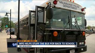 MPD helps stuff the bus for back to school - Video