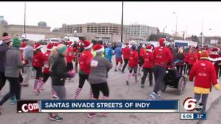 Thousands of runners take part in the Santa Hustle - Video