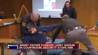 Father attacks Larry Nassar in court - Video