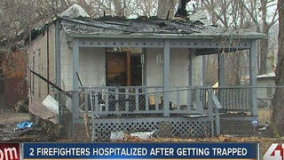 2 KC firefighters hospitalized after house fire - Video