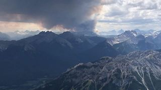 Smoke Rises from Wildfire in Alberta's Kootenay National Park - Video