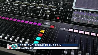 Summerfest sound equipment company working hard in the rain - Video